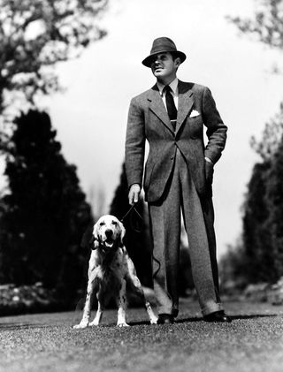 Clark Gable z psem na smyczy
