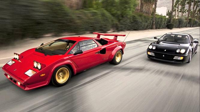 Lamborghini Countach i czarne Ferrari