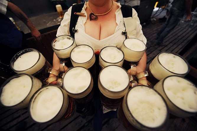 A waitress carries 12 litre-size glasses of beer in a beer tent during the Gillamoos folk festival in the southern German town of Abensberg on September 8, 2008. The world famous Oktoberfest beer festival will take place from September 20 to October 5, 2008 in Munich. AFP PHOTO DDP / OLIVER LANG GERMANY OUT (Photo credit should read OLIVER LANG/AFP/Getty Images)