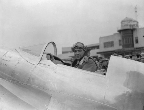 21 Jan 1937, Newark, New Jersey, USA --- Howard Hughes, famous pilot, seated in cockpit of his record breaking monoplane at Newark Airport. --- Image by © Bettmann/CORBIS